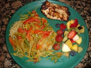 chicken, stir fry veggies and fruit