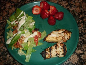 chicken, salad and strawberries