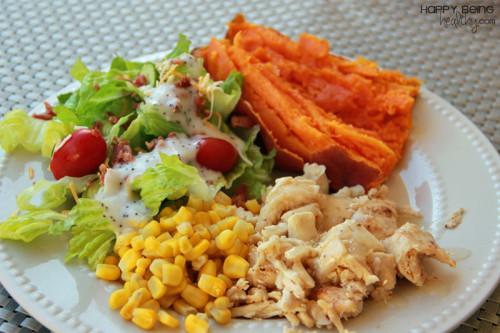 Chicken, sweet potato, salad and corn