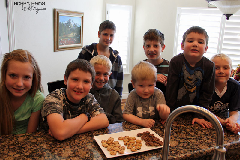 A whole bunch of kids getting ready to taste test Cooggies