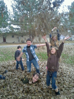 Kev and the kids playing in the leaves 2