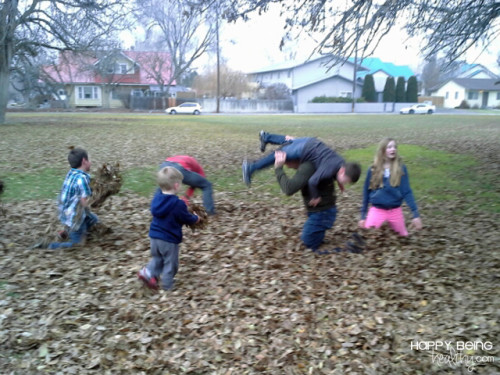 Kev and the kids playing in the leaves