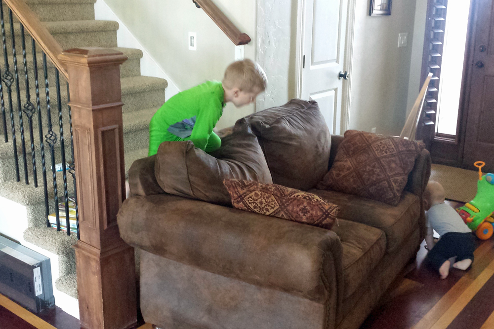 The couch in front of the stairs as a baby barricade
