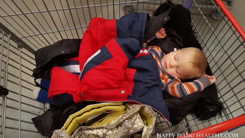 Sweet baby sleeping in grocery cart